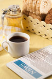 Tablet and cup of coffee. Morning news with tablet and cup of coffee stock photo