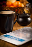 Tablet and cup of coffee. Morning news with tablet and cup of coffee stock images
