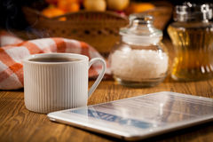 Tablet and cup of coffee Royalty Free Stock Images