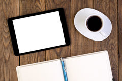 Tablet, cup of coffee and notebook on desk Royalty Free Stock Photos