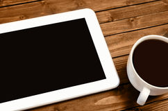 Tablet with cup of coffee Royalty Free Stock Photo
