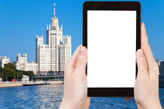Tablet with cut out screen and Moscow skyscraper Royalty Free Stock Images