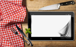 Tablet and Cutlery on a Table with Tablecloth Royalty Free Stock Image