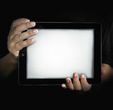 Tablet in the dark Stock Photography