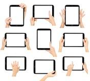 Tablet den Computer, der in einer Hand auf den weißen Hintergründen getrennt wird Stockfotos