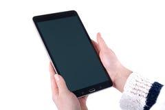 Tablet in den Frauenhänden auf einem weißen Hintergrund Stockfotos