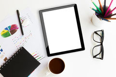 Tablet on desk workspace in office Royalty Free Stock Photos