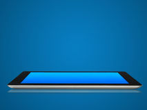 Tablet device in blue color of background. Stock Photos