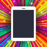 Tablet device on colorful rays Stock Image