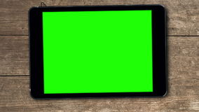 Tablet device with greenscreen stock video