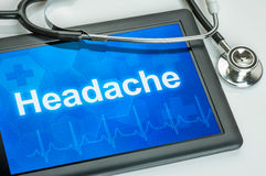Tablet with the diagnosis Headache stock photo