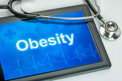 Tablet with the diagnosis obesity stock photography