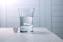 Tablet dissolved in a glass of water Stock Image