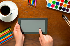 Tablet and drawing tools on the table Royalty Free Stock Image