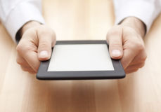 Tablet or e-book reader in hands stock image