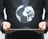 Tablet and earth Royalty Free Stock Photo