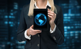 Tablet with earth. Businesswoman holding tablet with earth, close up Stock Image