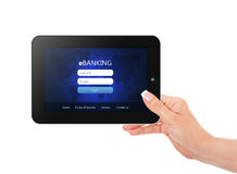 Tablet with ebanking login page holded by hand   over wh Royalty Free Stock Photo