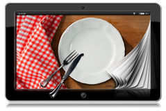 Tablet with Empty Plate and Cutlery Royalty Free Stock Image