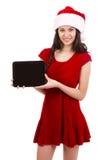 Tablet för kvinnligSanta holding Arkivbild