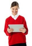 tablet för skola för datorflickaholding Fotografering för Bildbyråer