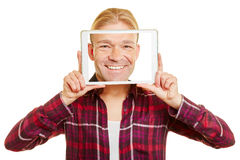 Tablet with the face of a man Stock Image