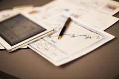 Tablet  and  financial charts Royalty Free Stock Photos
