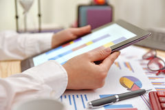 Tablet with financial charts Stock Photo