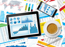 Tablet and financial papers Stock Photos