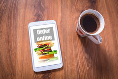 Tablet with food order Royalty Free Stock Images