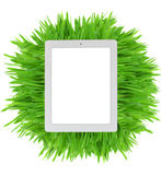 Tablet  on fresh green grass Royalty Free Stock Images