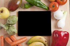 Tablet fruits and vegetables Stock Images