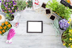 Tablet on gardening background Stock Photography