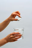 Tablet and glass of water in  hands Stock Photography