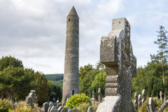 Tablet in the Glendalough Cemetery and The Round Tower Stock Photos