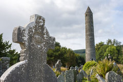 Tablet in the Glendalough Cemetery and The Round Tower Royalty Free Stock Photos