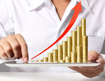 Tablet with the graph ,gold coins Stock Photography