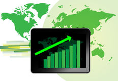 Tablet with graph for growth. With green world map background Royalty Free Stock Photo