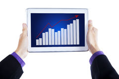 Tablet with graph in hands Royalty Free Stock Photography