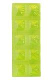Tablet in Green aluminum foil strip Stock Image
