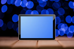 Tablet on the green bokeh backrounds. Royalty Free Stock Photography