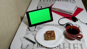 Tablet with green screen in cafe stock video footage