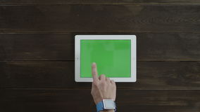 Tablet with greenscreen is used horizontally