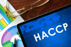 Tablet with HACCP on a table. Royalty Free Stock Image