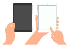 The tablet in hand. Finger on the touch screen. Mockups with blank screen. The tablet in hand. Finger on touch screen. Mockups with blank screen Royalty Free Stock Images
