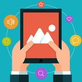 Tablet in hand. Flat style Royalty Free Stock Photos