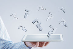 Tablet in hand with symbols Royalty Free Stock Image