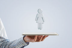 Tablet in hand with symbols. Close up of businessman hand holding tablet and glass symbols Stock Photography