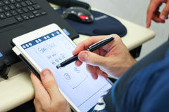 Tablet handling Stock Images