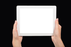 Tablet and Hands on Black Background Royalty Free Stock Photography
